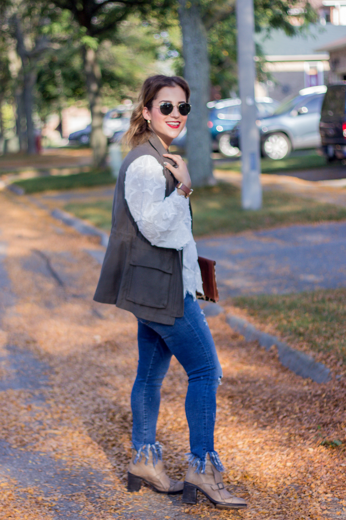 This casual outfit idea for early fall, features a white star embroidered top from Chicwish, military vest and jeans