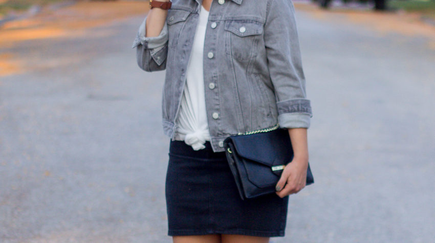 Canadian fashion and lifestyle blogger, Jackie at Something About That is wearing a grey denim jacket from Gap with a black denim skirt from Topshop