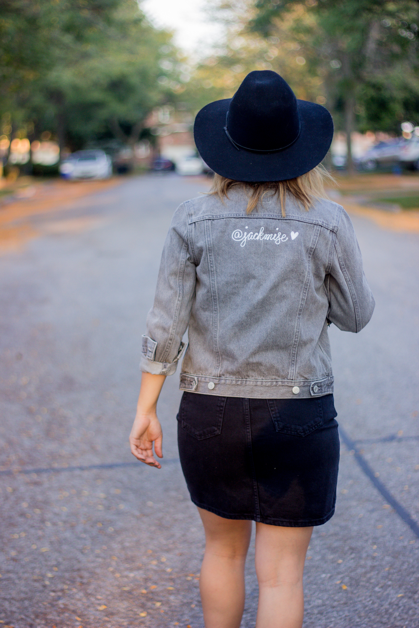 Fashion blogger Jackie Goldhar from Toronto is wearing a custom embroidered grey denim jacket from Gap, with her social handle, @jackmise