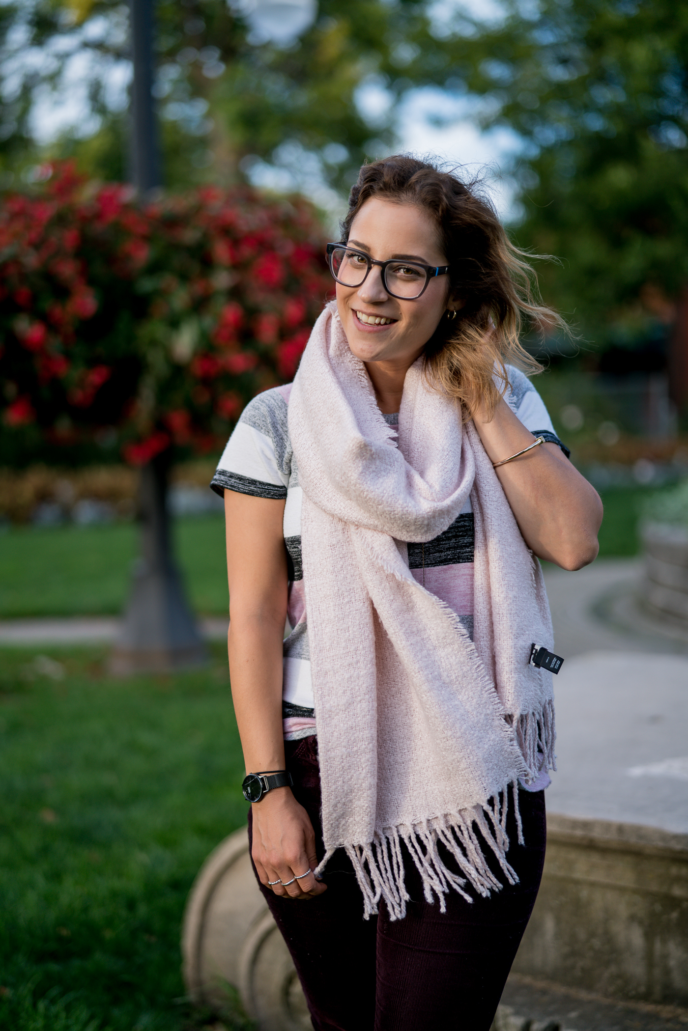 Canadian lifestyle and fashion blogger wearing a cozy pink scarf from Chapters Indigo, with a Gap softspun striped t-shirt