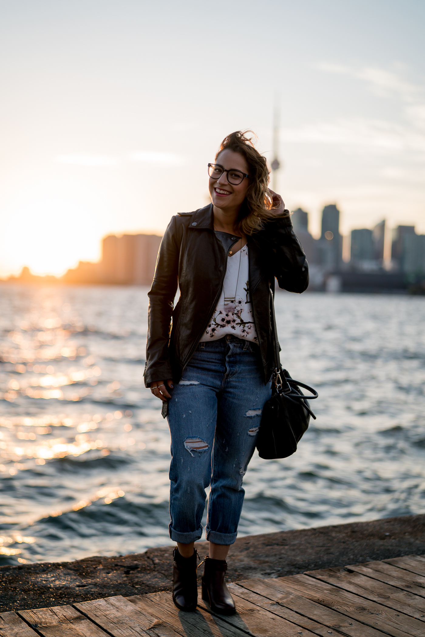 Toronto fashion and lifestyle blogger, Jackie Goldhar of Something About That, wearing a Soia and kyo leather moto jacket with Levis Wedgie Jeans
