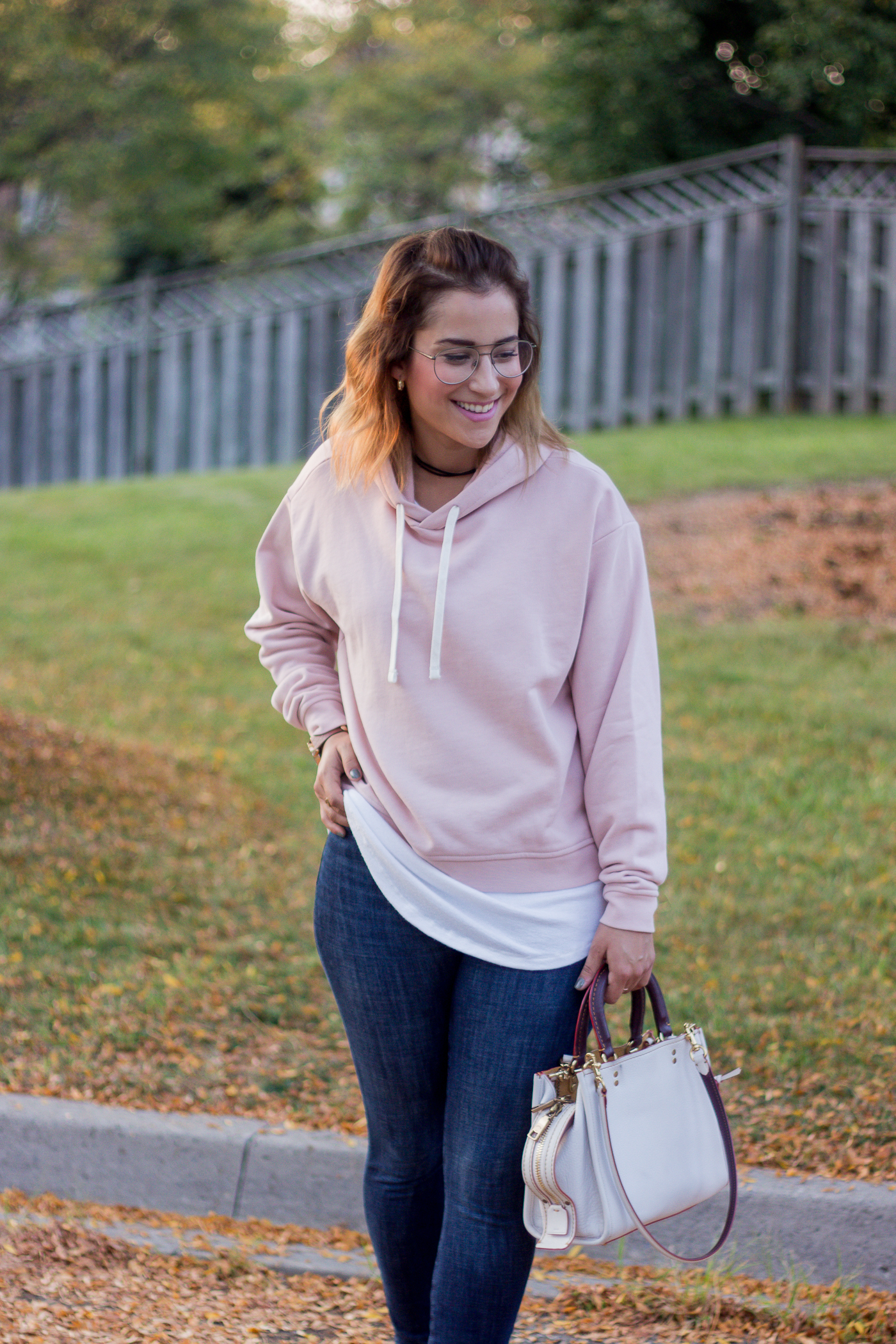 Toronto lifestyle and fashion blogger wearing a pastel pink hoodie from Everlane