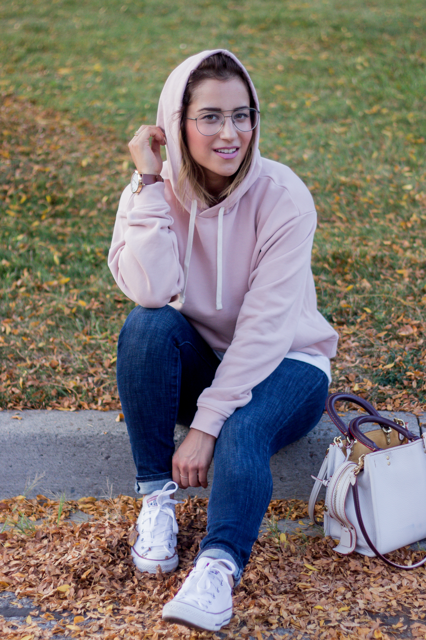 Canadian lifestyle blogger, Jackie of Something About That, sharing street style tips for how to wear a hoodie
