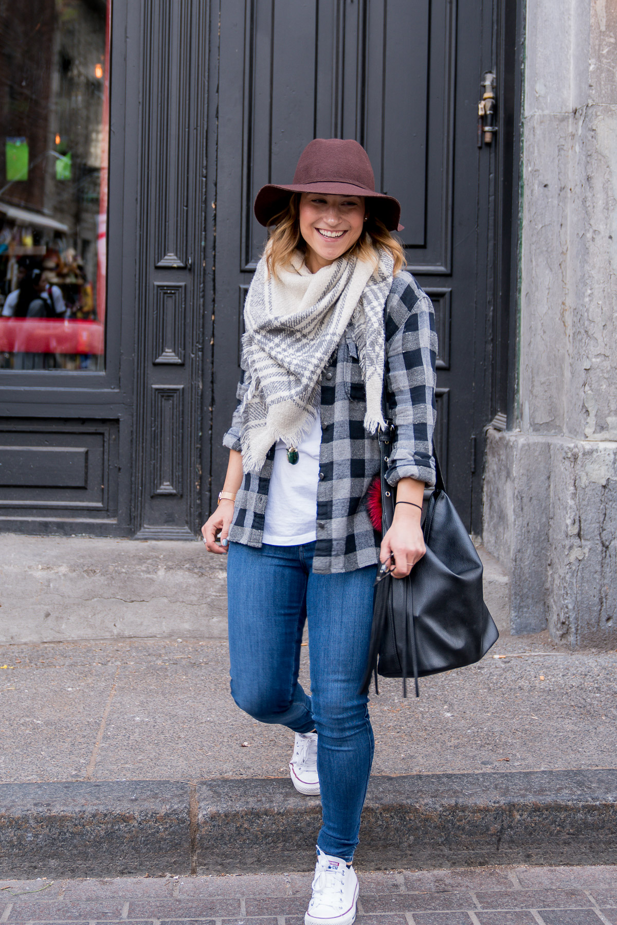 Jackie Goldhar is a petite-fashion and lifestyle blogger from Toronto, with an outfit mixing two different types of plaid with jeans