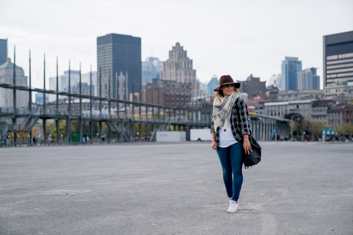 Toronto fashion and lifestyle blogger, Jackie from Something About That, wearing plaid and skinny jeans on a trip to Montreal during the fall