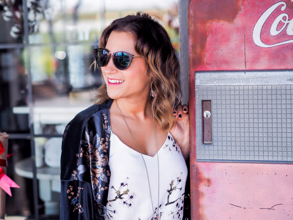 Prescription sunglasses from Clearly Contacts, with a simple floral outfit, as seen on lifestyle and fashion blogger Jackie Goldhar from Toronto