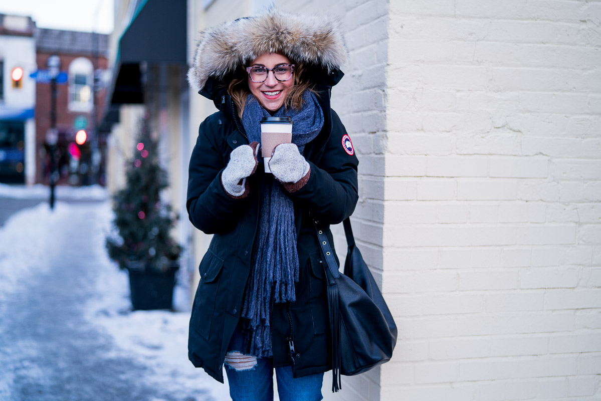 Winter outfit idea, from petite Canadian fashion blogger, Jackie from Something About That, who's wearing a Canada Goose jacket and a bulky scarf from Anthropologie