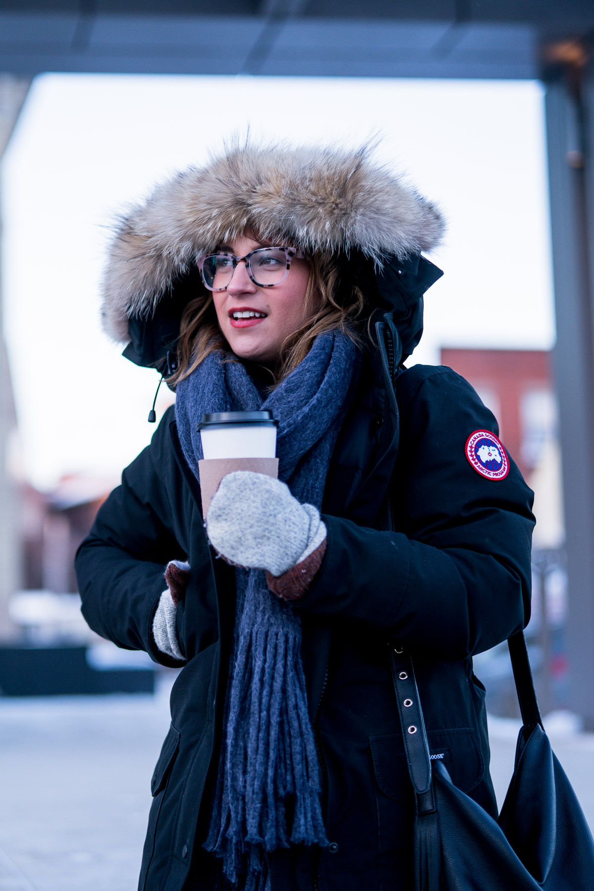 Canadian fashion and lifestyle blogger, Jackie from Something About That stays warm in her Canada Goose Jacket and prevloved mittens