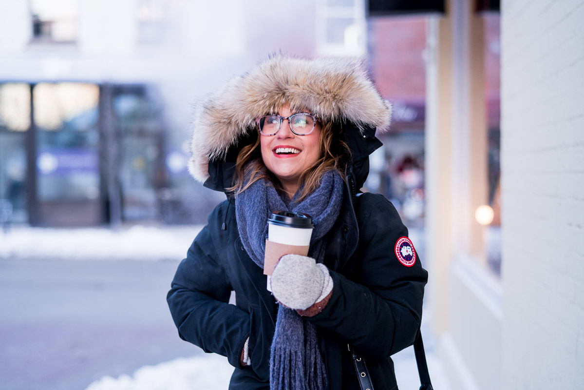 Bundled up in a Canada Goose jacket and coffee