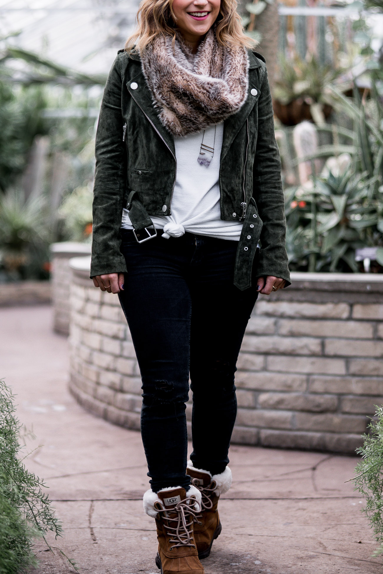 Jackie is a Canadian fashion blogger, who is wearing a faux fur scarf with a olive green suede Blank Denim Motorcycle jacket