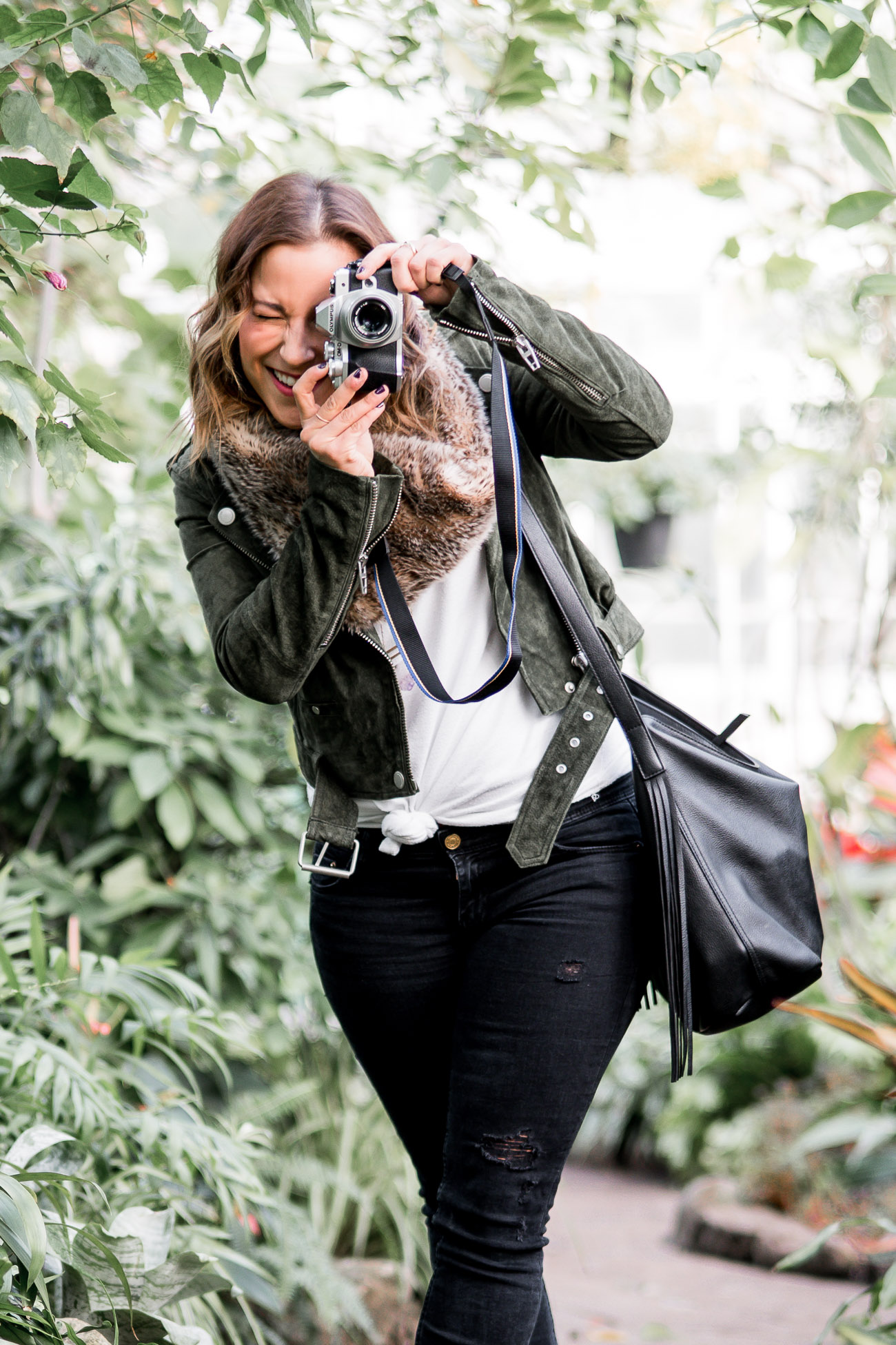 Jackie is a petite-lifestyle and fashion blogger, from Toronto, showing how to wear a suede moto jacket with black jeans and faux fur