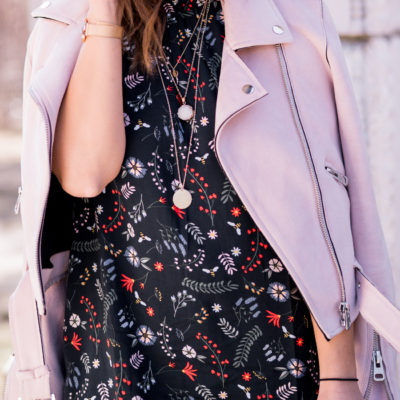Pink moto jacket with printed floral dress from the Simons Bee The Change campaign