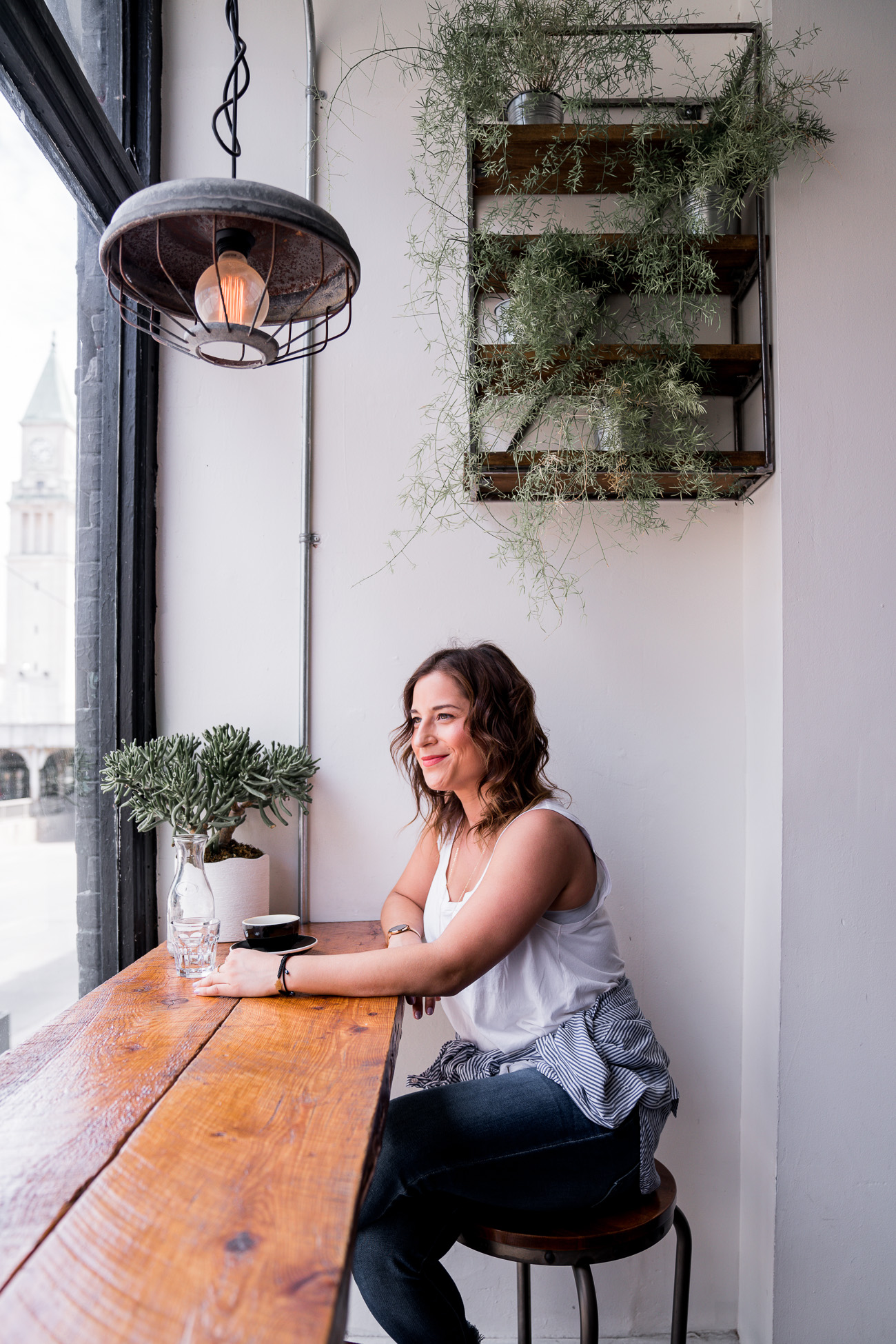 Toronto lifestyle and fashion blogger, Jackie Goldhar, sitting at Boxcar Social and enjoying the midtown views