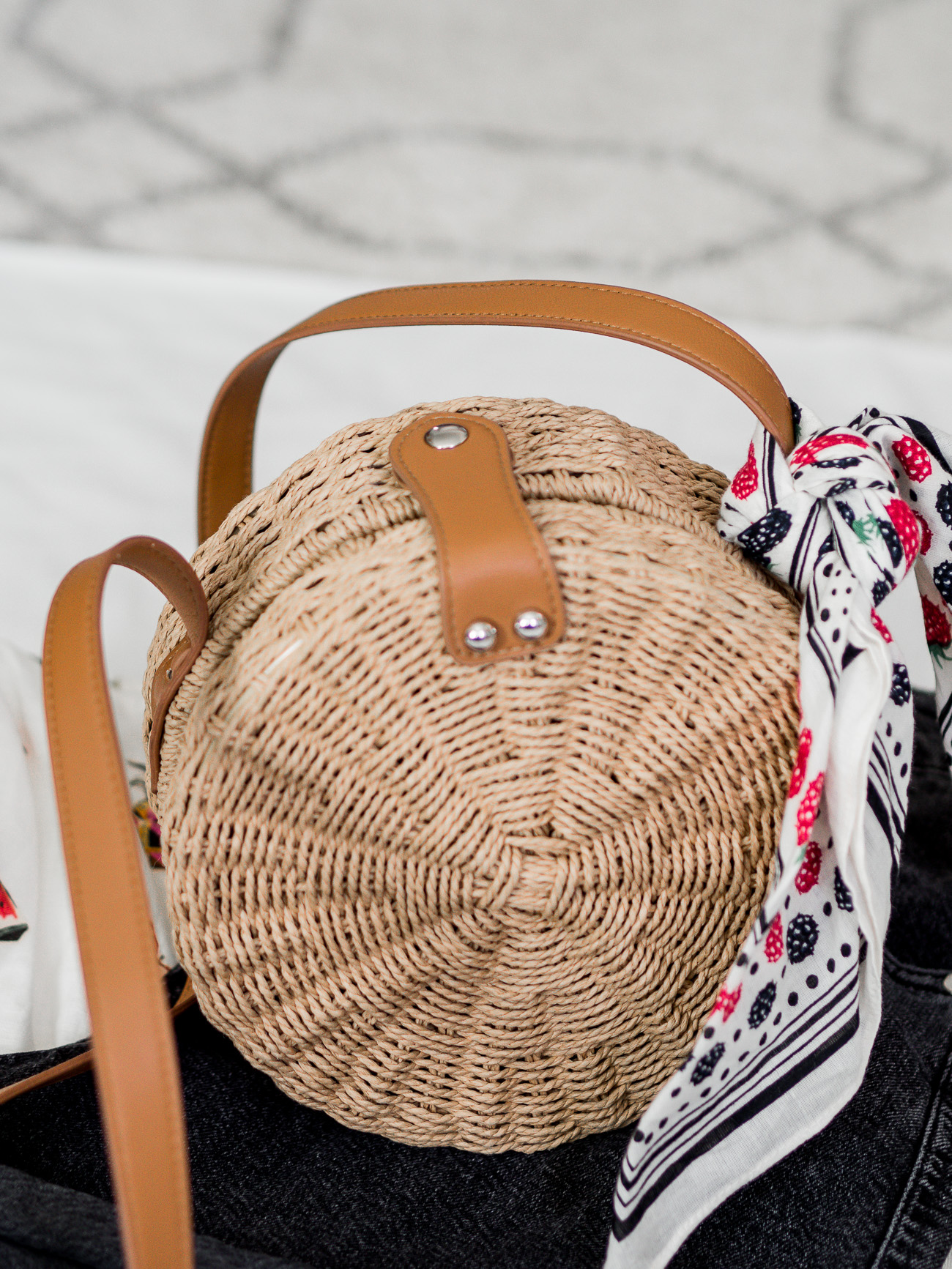 Really cute round straw bag from Topshop, which is under $50 and won't break the bank
