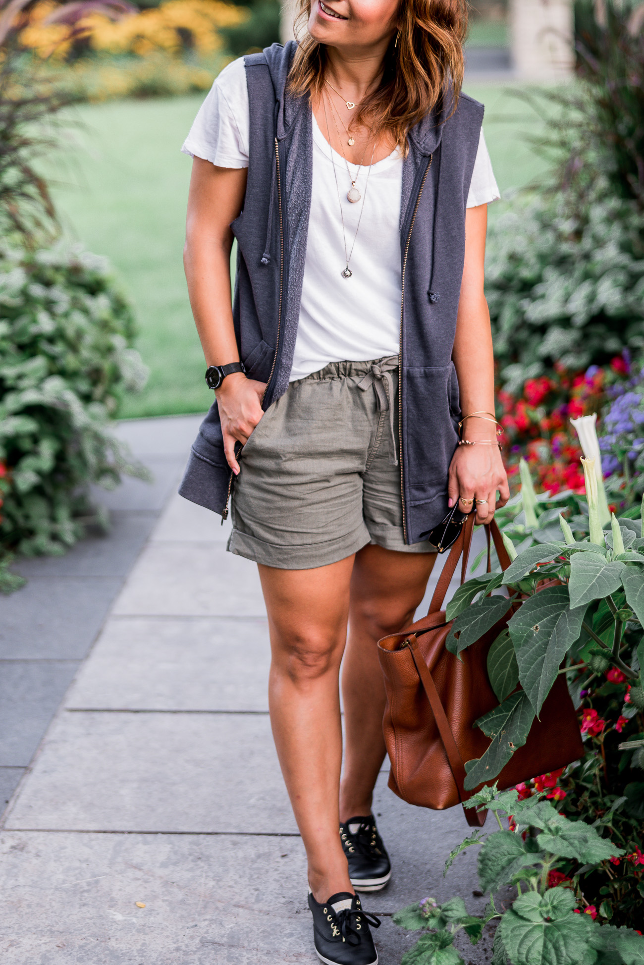 Toronto blogger, Jackie Goldhar, wearing a hooded sweatshirt vest, found at Nordstrom Rack at Vaughan Mills