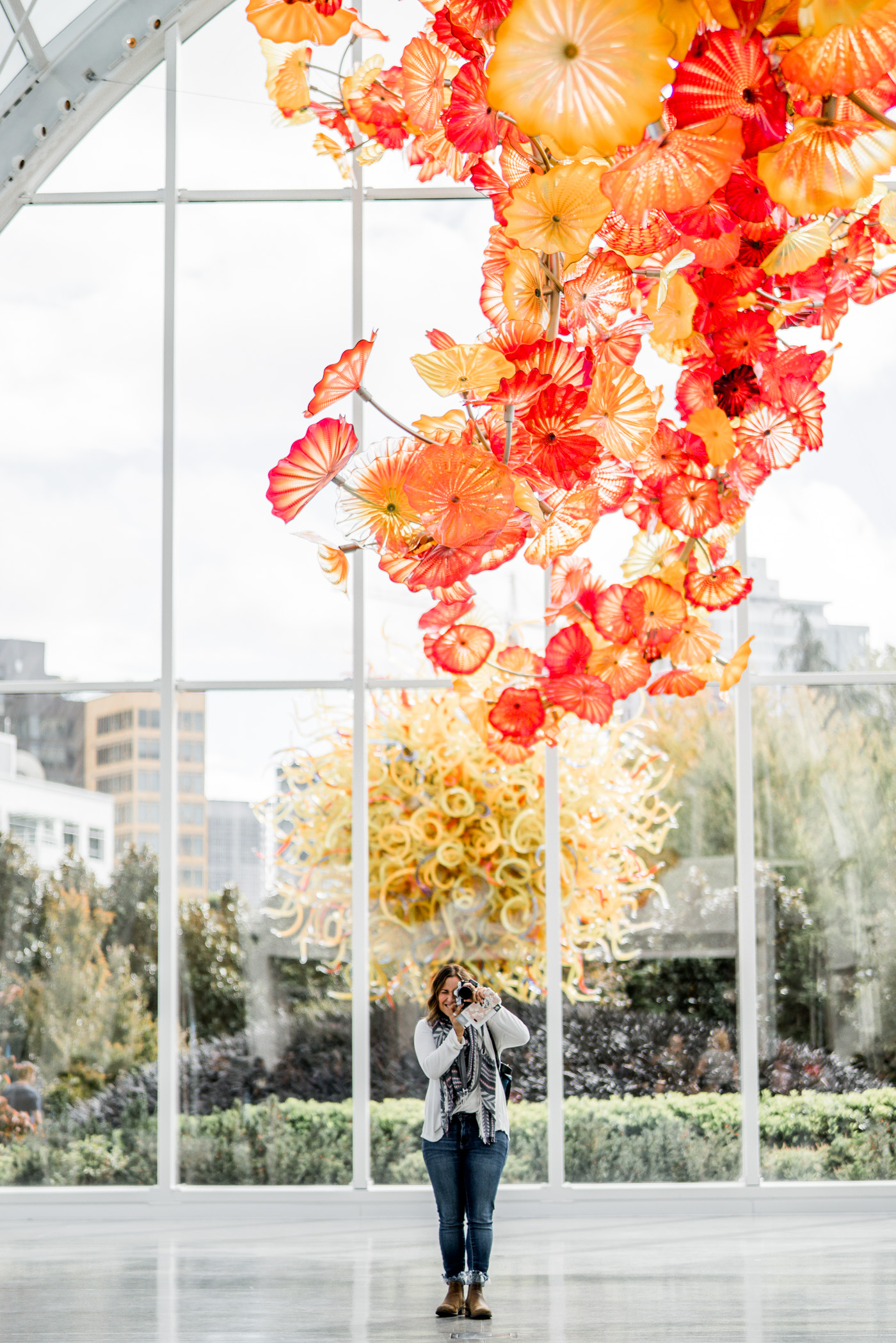 Taking photos at the Chihuly Garden and Glass in Seattle, before visiting the top of the Space Needle